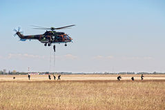 Helicopter and soldiers in action Royalty Free Stock Image