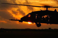 Helicopter soldiers at sunset Royalty Free Stock Photo