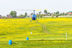 Helicopter sport training. Assistant of Helicopter pilot must put the buoy on rope into the barrell stock photography
