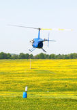 Helicopter sport training. Assistant of Helicopter pilot must put the buoy on rope into the barrell royalty free stock image