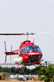 Helicopter spraying crops Stock Images
