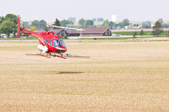 Helicopter spraying crops in Colorado, USA. Helicopter crop-duster spraying insecticide on a cornfield in rural Colorado, USA royalty free stock images