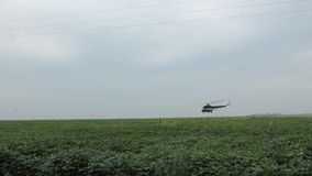 Helicopter spraying fertilizer Stock Photos