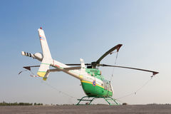 Helicopter standing on landing strip in airfield. Low angle view Stock Photography