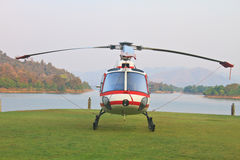 Helicopter standing on landing strip in airfield Royalty Free Stock Images