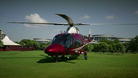 Helicopter starting with the beautiful green takeoff area stock footage