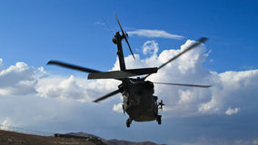 Helicopter starting from military base Royalty Free Stock Photography