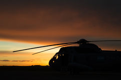 Helicopter at sunrise. Helicopter silhouette at sunrise Stock Photos