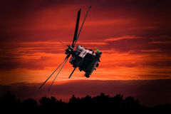 Helicopter at sunset Royalty Free Stock Photo