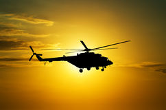 Helicopter at sunset. In the sky royalty free stock image