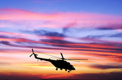 Helicopter at sunset. In the sky royalty free stock images