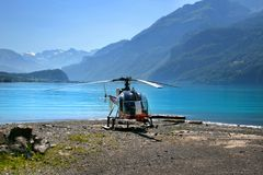 Helicopter in Swiss mountains Royalty Free Stock Photo