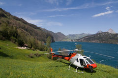 Helicopter, Switzerland. Helicopter in Alps, lakeside, Switzerland Royalty Free Stock Image