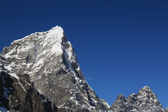 Helicopter tabuche peak  from everest trek route Stock Photography
