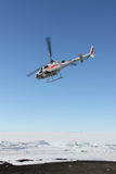 Helicopter taking off in Antarctica Royalty Free Stock Photos