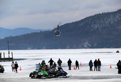 Helicopter taking off from Lake George Winterfest Royalty Free Stock Images