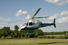 Helicopter taking off or landing in a field Royalty Free Stock Photography