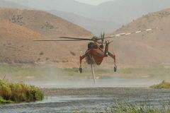 Helicopter taking in water Royalty Free Stock Photo
