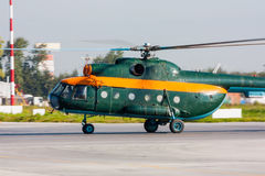 Helicopter taxiing in the airport. Helicopter taxiing on the airport apron royalty free stock photo