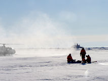 Helicopter Team. Helicopter and Team on Artic expedition Stock Photo