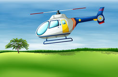 A helicopter about to land Royalty Free Stock Images