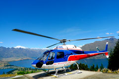 Helicopter on top of Bob s Peak with the view on Lake Wakatipu in Queenstown, New Zealand. QUEENSTOWN, NEW ZEALAND - JANUARY 26: Helicopter on top of Bob s Peak stock photos