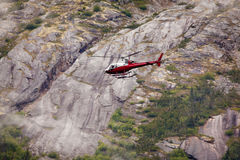 Helicopter touring glaciers. Helicopter flies tourists to view glaciers in Alaska royalty free stock images
