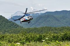 Helicopter with tourists flying in the forest. Kamchatka Peninsula Stock Photos