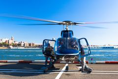 Helicopter with tourists in heliport in New York. USA. People inside cabin of helicopter on background river and New York stock photo