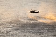 Helicopter training mission over Columbia river royalty free stock photography