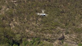 Helicopter and trees. A full shot of a helictopter and trees with smoke. Camera moves forward stock video footage