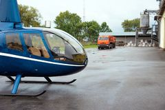 Helicopter and truck near the warehouse with flour.  stock photo