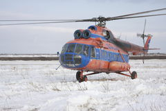 Helicopter in tundra. Helicopter Mi-8 to air companies Taymyr in tundra Royalty Free Stock Image