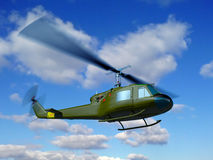 Helicopter UH-1E fly Royalty Free Stock Image