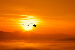 Helicopter on the valley at sunset Stock Images