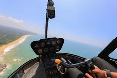 Helicopter Robinson R44 inside view. Helicopter view inside the cabin flies over the ocean Stock Images