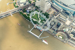 Helicopter view of London Eye and buildings along Thames river Royalty Free Stock Photos