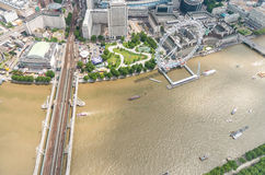Helicopter view of London Panoramic Wheel and river Thames.  royalty free stock image