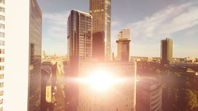 Helicopter view of modern cityscape skyline. sun beaming light stock video