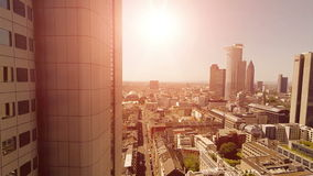 Helicopter view of modern cityscape skyline. sun beaming light stock footage