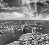 Helicopter view of Sydney Harbor Bridge and city skyline, Austra. Lia Stock Photos