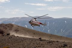 Helicopter on the volcano ksudach royalty free stock images