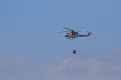 Forest Fire Helicopter- Fighting Bush Fire from The Air Royalty Free Stock Images