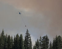 Helicopter at wildfire Stock Photos