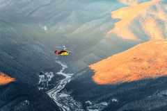 Helicopter winter mountain aerial view Stock Photos