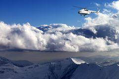 Helicopter in winter mountains Royalty Free Stock Images