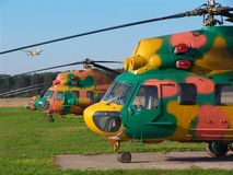 Helicopters. Multicolored helicopters in a field aerodrome Royalty Free Stock Image