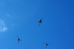 Helicopters. 3 helicopters on blue sky background, room for text on top Royalty Free Stock Photo