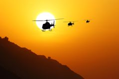 Helicopters against sun Stock Photo