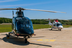 Helicopters on an airfield. Two helicopters on  an airfield Royalty Free Stock Photo